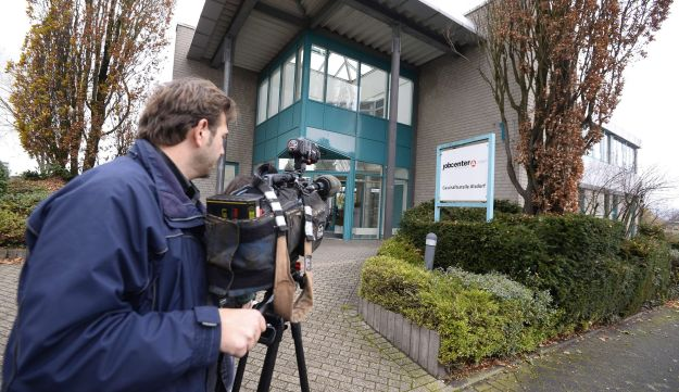 A camerman films outside the JobCenter in Alsdorf near Aachen, western Germany were three arrests were made on Novermber 17, 2105.