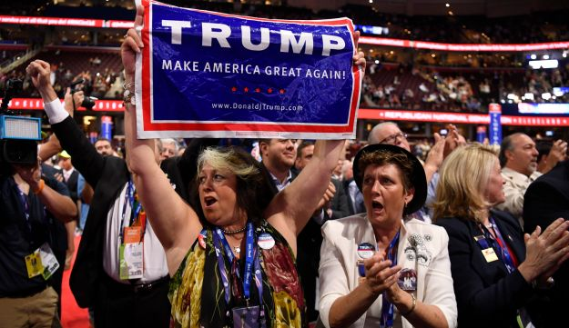 A delegate holds a campaign sign for Donald Trump during the Republican National Convention in Cleveland, July 19, 2016.