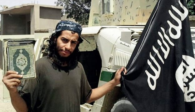 Abdelhamid Abaaoud, the presumed architect of the attacks in Paris, holding an ISIS flag