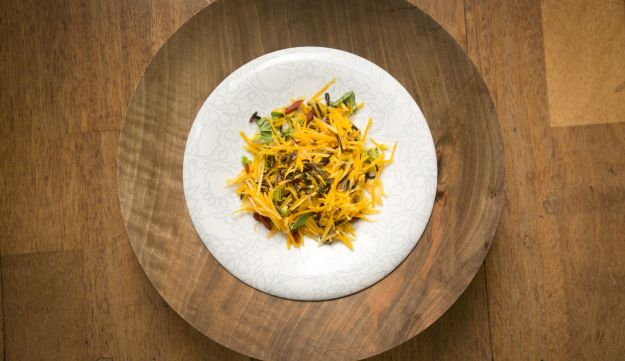 A plate of squash and goji salad.