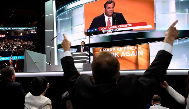A delegate cheers while Chris Christie, governor of New Jersey, speaks during the Republican National Convention (RNC) in Cleveland, Ohio, U.S., on Tuesday, July 19, 2016.