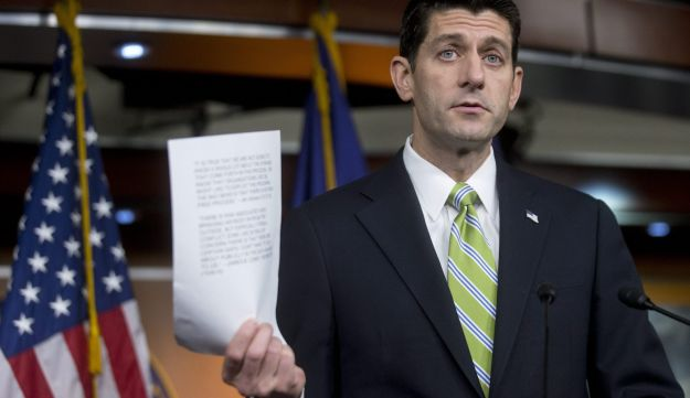 U.S. House Speaker Paul Ryan, a Republican, holds up testimony during a news conference on Capitol Hill in Washington, D.C., November 19, 2015.