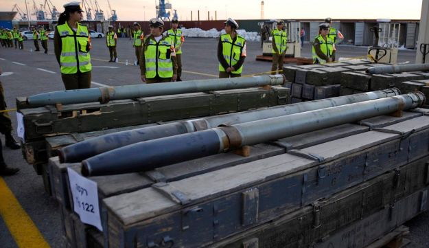 Israeli soldiers stand near Iranian rockets for Hezbollah that, according to the IDF, were found on the Antigua-flagged Francop vessel, intercepted in the Mediterranean 160 km from Israel. Ashdod November 4, 2009.