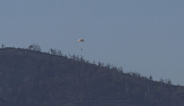 One Russian pilot parachutes to the ground after his place was shot down by Turkish jets, November 24, 2015.