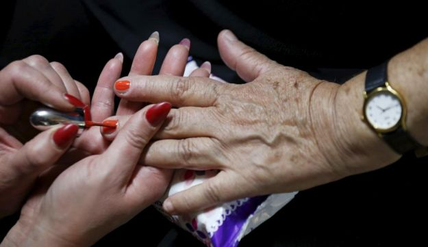 A Holocaust survivor has her nails done during preparations ahead of a beauty contest for survivors of the Nazi genocide in the northern Israeli city of Haifa. November 24, 2015.