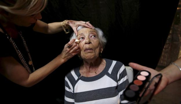 Rivka Kushnir, 85, a Holocaust survivor, has her make-up done during preparations ahead of a beauty contest for survivors of the Nazi genocide in the northern Israeli city of Haifa. November 24, 2015.