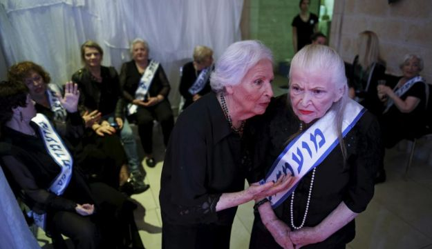 Holocaust survivors are seen backstage during a beauty contest for survivors of the Nazi genocide in the northern Israeli city of Haifa. November 24, 2015.