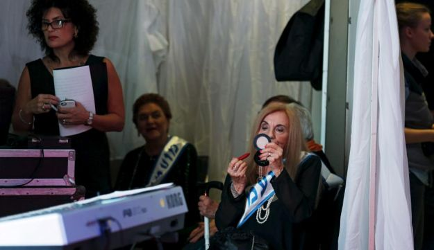 Rita Casimo Brown, 81, a Holocaust survivor, has her make-up done during a beauty contest for survivors of the Nazi genocide in the northern Israeli city of Haifa. November 24, 2015.