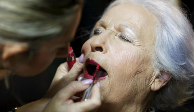 Holocaust survivor Hava Hershkovitz, 82, a previous beauty queen in the competition, has her make-up done during preparations ahead of a beauty contest for survivors of the Nazi genocide in the northern Israeli city of Haifa. November 24, 2015.