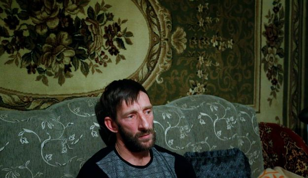 Abdulla Magomedov, brother of Rashid Magomedov who joined ISIS and was killed in Syria, sits at home in the village of Komsomolskoye, Dagestan, Russia, November 12, 2015.