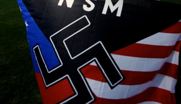 File photo: Jeff Hall holds a National Socialist Movement flag in Riverside, Calif. Oct. 22, 2010