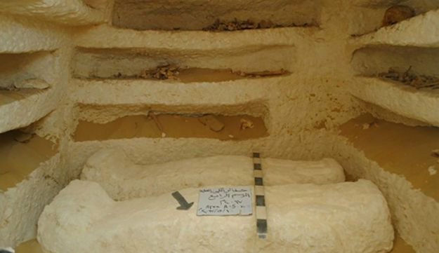 Sarcophagi in one of three tombs that were discovered at the cemetery dating back about 2,000 years in the al-Kamin al-Sahrawi area in Minya province, south of Cairo.