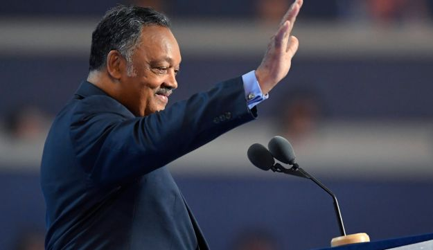 Rev. Jesse Jackson waves from the podium during the third day of the Democratic National Convention in Philadelphia , Wednesday, July 27, 2016.