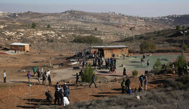 Young Israeli settlers gather in the settlement outpost of Amona in the West Bank, Dec. 9, 2016.