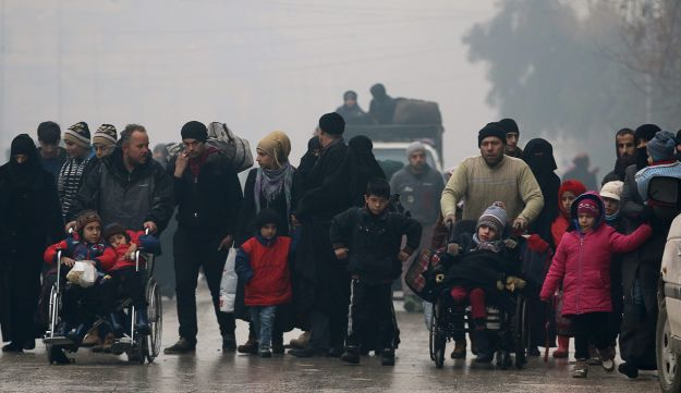File photo: People flee deeper into the remaining rebel-held areas of Aleppo, Syria, December 13, 2016.