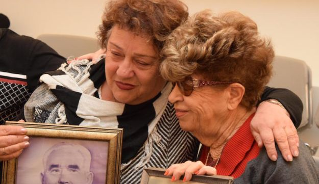Fania Blakay, left, embracing her cousin Henia Moskowitz after they were united at the Yad Vashem Holocaust museum in Jerusalem, Dec. 13, 2016.