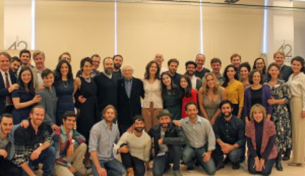 "Lyricist Sheldon Harnick, standing center, and the cast of ""Fiddler on the Roof"" at New West 42nd Street Studios in New York City, New York."