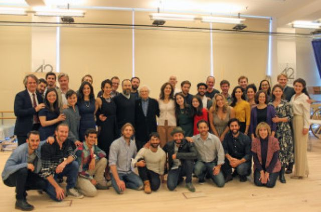 """Lyricist Sheldon Harnick, standing center, and the cast of """"Fiddler on the Roof"""" at New West 42nd Street Studios in New York City, New York."""