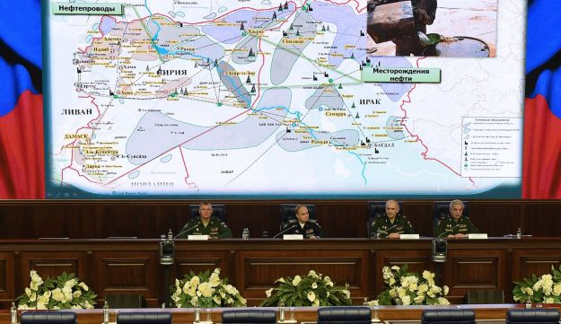 Russia's top military officials hold a press conference on the fight against terrorism in Syria at the National Defence Control Centre of the Russian Federation in Moscow on December 2, 2015. Russia's defence ministry on December 2 accused Turkish President Recep Tayyip Erdogan and his family of involvement in illegal oil trade with Islamic State jihadists, as a dispute rages over Ankara's downing of one of Moscow's warplanes.