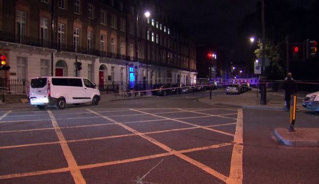 The area where a knife attack happened is cordoned off in London Thursday, Aug. 4, 2016.