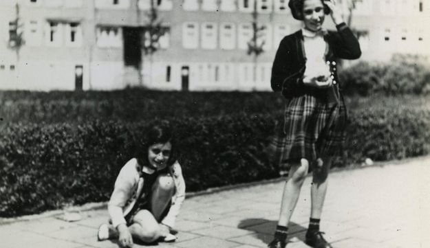 Anne Frank, left, plays with her friend Hanneli Goslar, right, on the Merwedeplein square in Amsterdam, 1941.