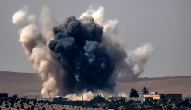 This picture taken from the Turkish Syrian border city of Karkamis on August 24, 2016 shows smoke following air strikes by a Turkish Army jet fighter on the Syrian Turkish border village of Jarabulus.