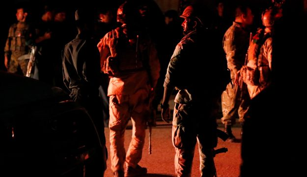 Afghan security forces arrive at the site of an attack at American University of Afghanistan in Kabul, Afghanistan, August 24, 2016.