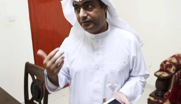 Human rights activist Ahmed Mansoor speaks to Associated Press journalists in Ajman, United Arab Emirates, on Thursday, Aug. 25, 2016. Mansoor was recently targeted by spyware that can hack into Apple's iPhone handset. The company said Thursday it has updated its security.