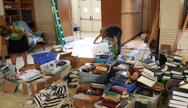 Damaged Jewish prayer books and other Jewish texts being sorted through at United Orthodox Synagogues in Houston.