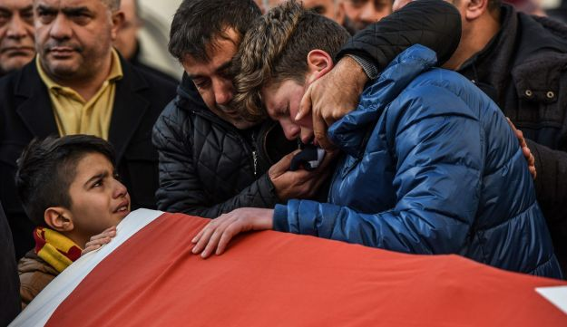 Relatives of Ayhan Arik, one of the victims of the Reina night club attack, mourn during his funeral in Istanbul, January 1, 2017.