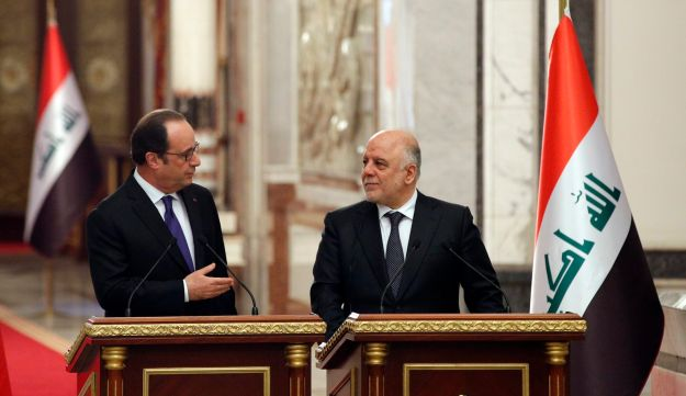 French President Francois Hollande (left) at a news conference with Iraq's Prime Minister Haider al-Abadi, in Baghdad, Iraq, January 2, 2017.