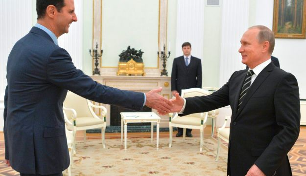 Syrian President Bashar Assad and Russian President Vladimir Putin meeting in Moscow, October 2015.