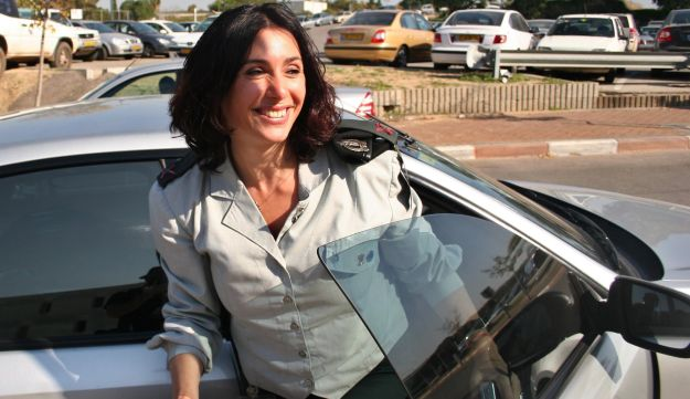 Miri Regev in uniform exits a car, during her stint as IDF Spokesperson.
