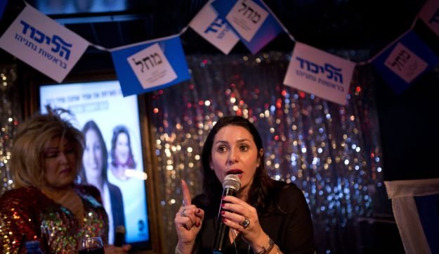 Likud Member of Knesset Miri Regev campaigns for the 2015 election at an event aimed at the LGBT community in a Tel Aviv bar.
