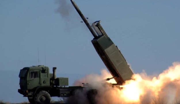 The High Mobility Artillery Rocket System fires the Army's new guided Multiple Launch Rocket System during testing at White Sands Missile Range.