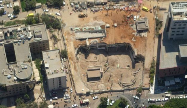 Aerial view of the building collapse at Tel Aviv construction site that injured at least 18 people with at least half a dozen other victims feared trapped in rubble on September 5, 2016.