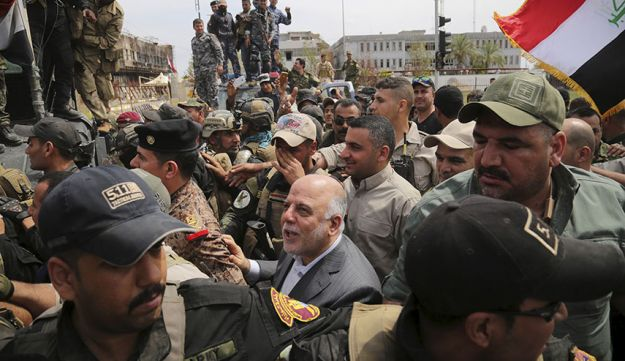 Prime Minister Haidar al-Abadi touring the city of Tikrit after Iraq security forces regained control from Islamic State militants on April 1, 2015.