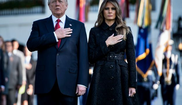 US President Donald Trump and first lady Melania Trump observing a moment of silence at the White House in Washington, during the 16th anniversary of 9/11 on September 11, 2017.
