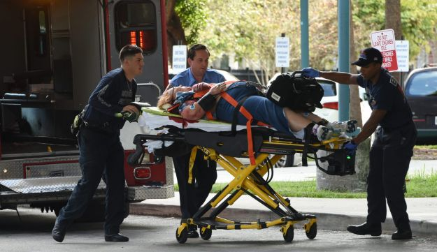 An injured woman is taken into Broward Health Trauma Center in Fort Lauderdale, Fla., after a shooting at the Fort Lauderdale-Hollywood International Airport on Jan. 6, 2017.