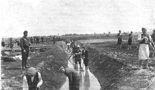 Slave laborers digging irrigation ditch in Nazi camp in Poland, 1940.