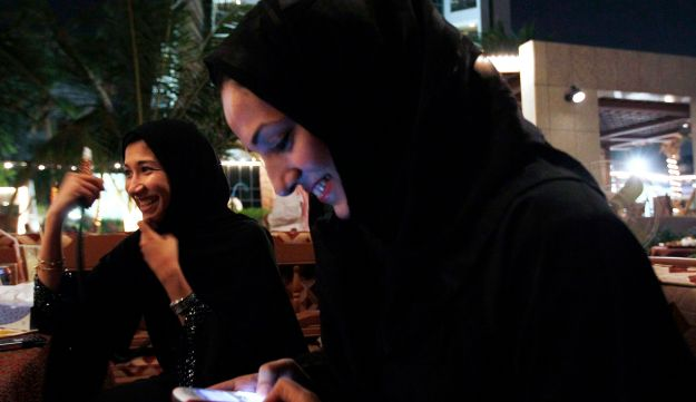 In this 2010 file photo, a Saudi woman looks at her phone in Jeddah