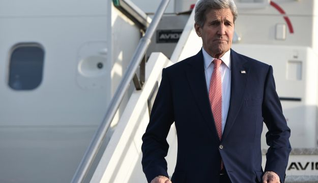 U.S. Secretary of State John Kerry steps off a plane upon arrival at Ciampino Airport near Rome, December 13, 2015.