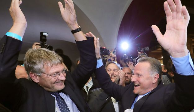 AfD's party chairman and top candidate celebrate after the first exit polls were published in Berlin, Germany, September 18, 2016.