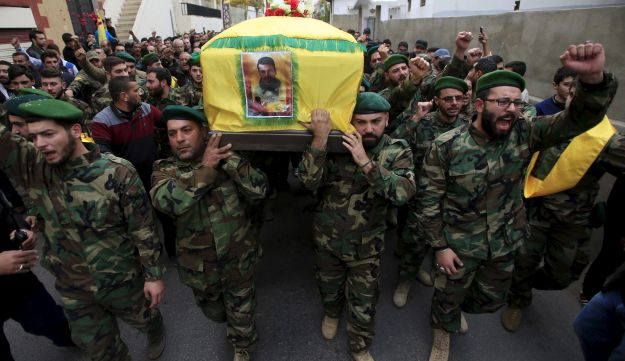 Lebanon's Hezbollah members carry the coffin of their comrade, Mohamad Sfawi, who was killed fighting alongside Syrian army forces in Syria, during his funeral in Qnarit village, southern Lebanon, December 13, 2015.