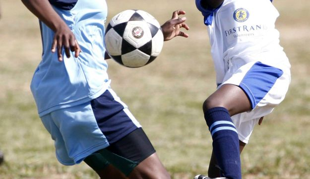 School girls competing for the ball during a Dreamfields project, Orange Farm township, south of Johannesburg, May 8, 2010.
