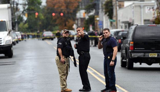 Law enforcement officers secure the area where they allegedly arrested terror suspect Ahmad Khan Rahami following a shootout in Linden, New Jersey, September 19, 2016.