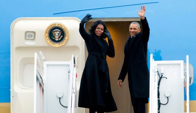 President Barack Obama and first lady Michelle Obama wave from Air Force One at Andrews Air Force Base, Md., Tuesday, Jan. 10, 2017.