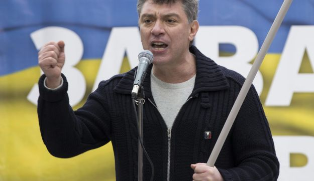 In this photo taken on Saturday, March 15, 2014, Boris Nemtsov, a former Russian deputy prime minister and opposition leader addresses demonstrators during a massive rally to oppose president Vladimir Putin's policies in Ukraine, in Moscow, Russia.