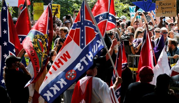 Members of the Ku Klux Klan facing counterprotesters as they rally in support of Confederate monuments in Charlottesville, Virginia, on July 8, 2017.
