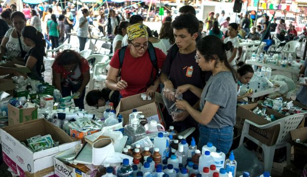 Volunteers sort through medicine at a collection center in the town of Tlayacapan, Morelos State, Mexico, September 21, 2017.